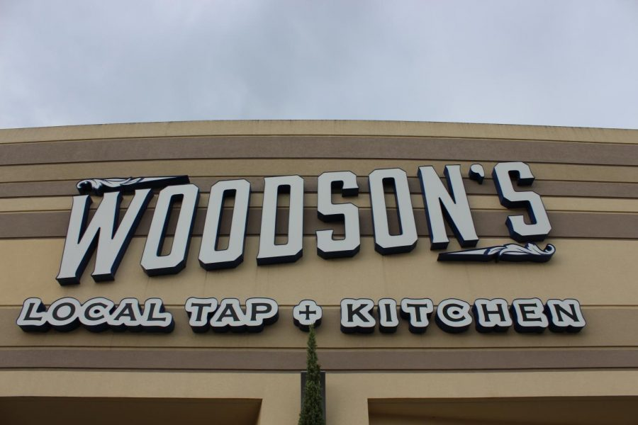 Store front of Woodson's Local Tap + Kitchen.