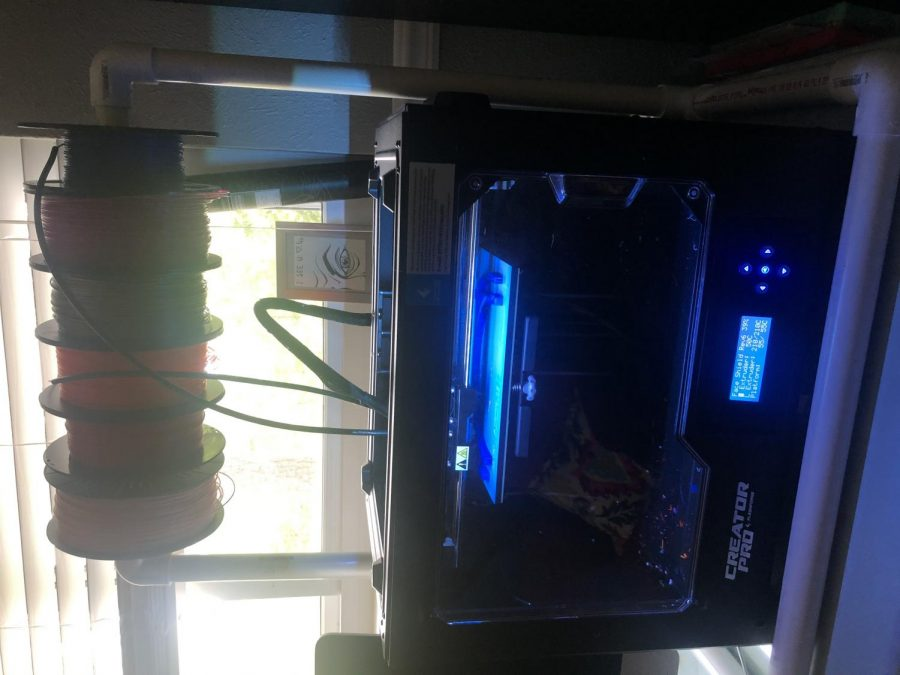 3D printer at work in Lauren Hamel's home