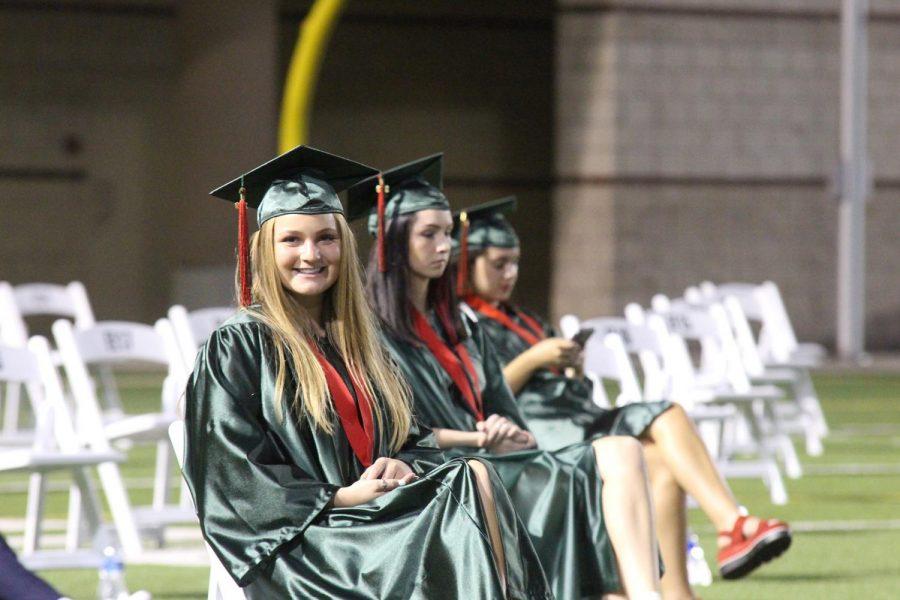 Graduates relax in the stadium prior to the 8 p.m ceremony at Woodforest Bank Stadium.