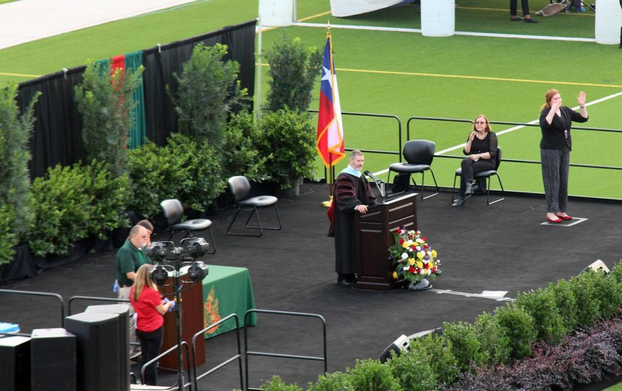 Principal Dr. Ted Landry addresses the graduates during the June 2 commencement ceremony at Woodforest Bank.  This was the morning ceremony; a second will be held at 8 p.m.