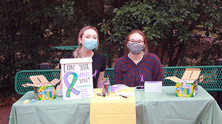 Grace Murphy (left) and Leilani Beard (right) in the TWHS courtyard manning the chalk station.