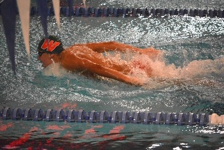 Fields swims the butterfly in a meet against Stratford at Woodforest natatorium in 2018.