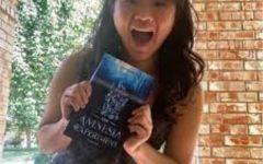At home with her unforgettable novel, junior Caroline Wei celebrates.