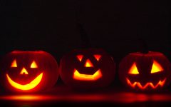 Set the mood for a spooky movie with pumpkins.