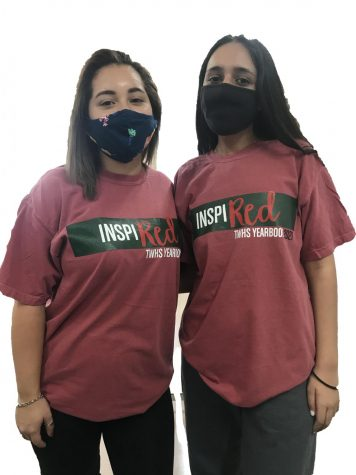 Staffers Morgan Arnold (left) and Sarah Aghajan wear their yearbook t-shirts while working on this year