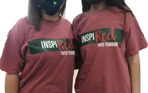 Staffers Morgan Arnold (left) and Sarah Aghajan wear their yearbook t-shirts while working on this year's book.