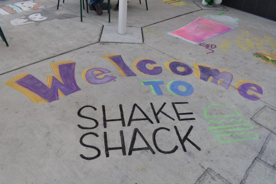 Chalking the walk outside on opening day with art and messages was fun for Art Club.
