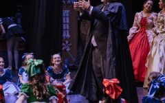 Herr Drosselmeyer, played by Chuck Schuetz, holds guests at the party in his spell during