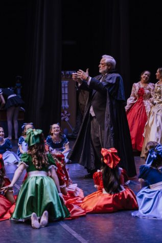 "Herr Drosselmeyer, played by Chuck Schuetz, holds guests at the party in his spell during ""The Nutcracker"" at Cynthia Woods Mitchell Pavilion on Nov. 17."