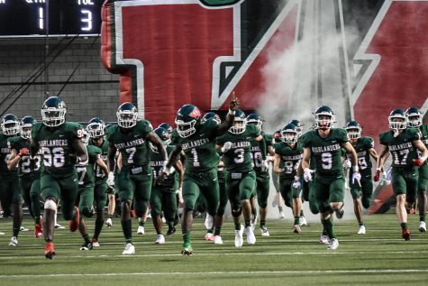Seniors Martrell Harris, Jr (7) and JoBarre Reed (1) lead the team out of the fieldhouse for the first game of the season against the Langham Creek Lobos at Woodforest Bank Stadium.