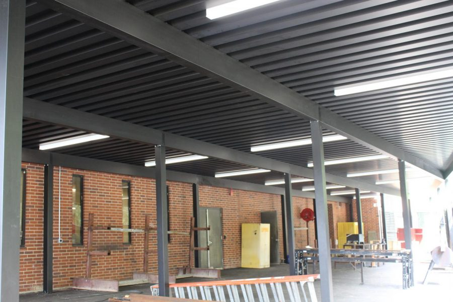 A new outdoor canopy, complete with overhead lighting, allows students to work outside.
