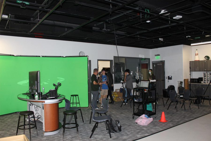 The greenscreen in the studio and the anchor desk will be used during the filming of the weekly announcements.