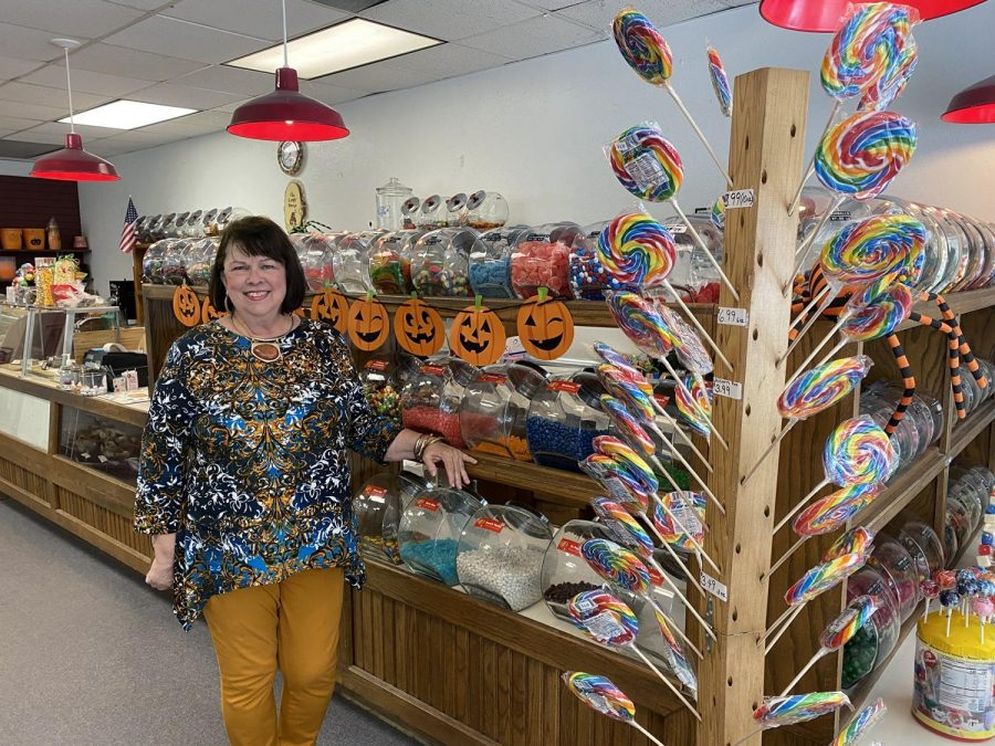 One of the five owners, Wanda Graham, in the store decorated for Halloween.   The store officially opened under new ownership on Sept. 1.