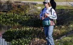 A team member fishes at Lake Conroe during a tournament last year.