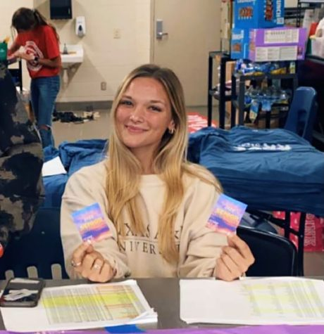 Lizzy Prather handing out senior sunrise tickets in the cafeteria Sept. 30.  Tickets were free and the breakfast was sponsored by Student Council.