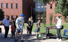 Stone Meng (12) and Daniela Llaguno (11) are in the courtyard at TWHS.  They demonstrated one of the TWHS robotics robots.